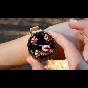 Motorola 360 Smartwatch with rose gold face.